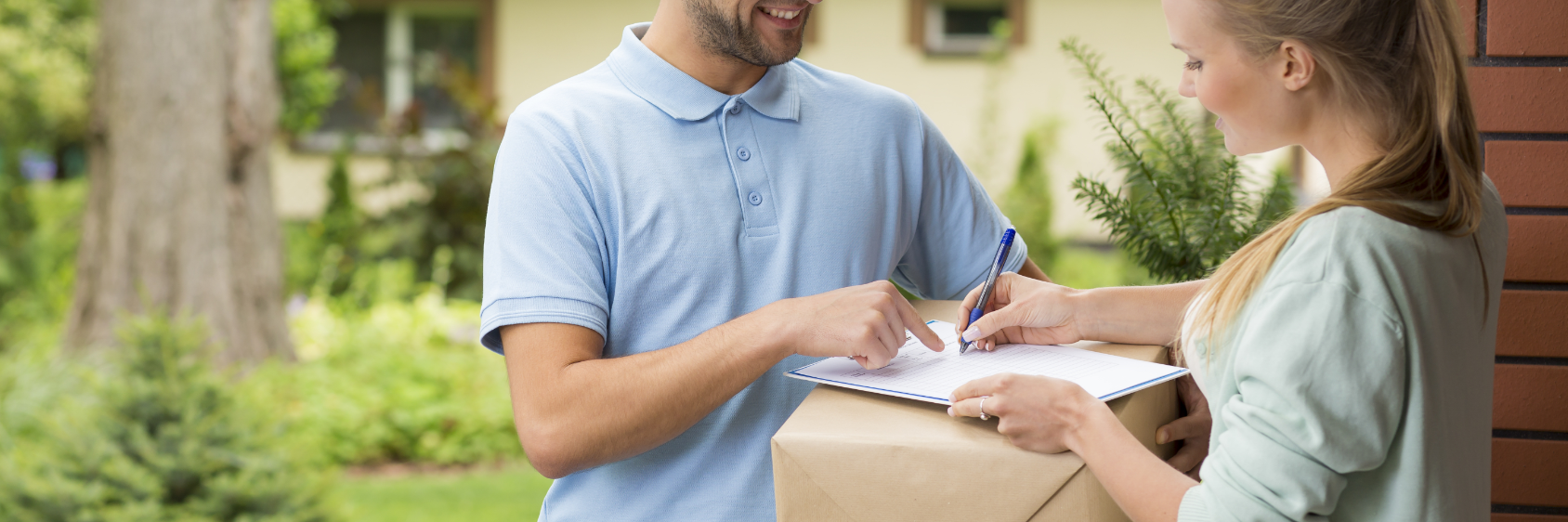 A man delivers a parcel to a woman